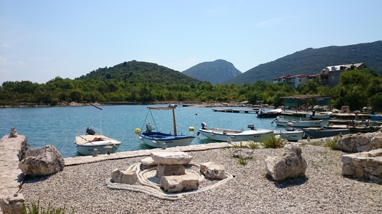 The same spot from a different angle. Loved the stone chairs and table and the brod boats)