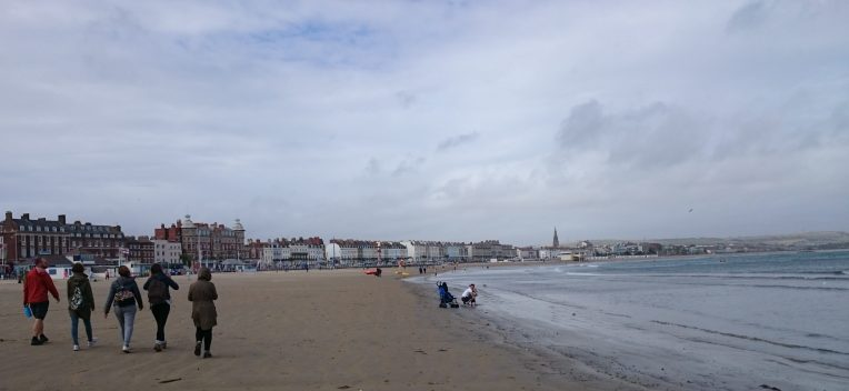 Walking along Weymouth Beach